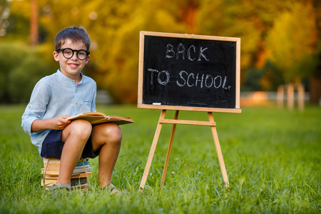 Cute little schoolboy feeling excited about going back to school photo