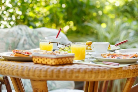 Breakfast in the garden on beautiful summer day Stock Photo