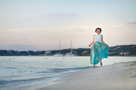 Young beautiful woman enjoying beach vacation, Sardegna, Italy Banco de Imagens