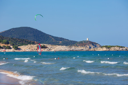 Panorama of beautiful beach with kitesurfer in Sardinia, Italy