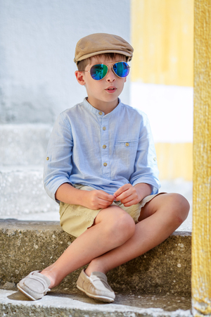 Cheerful little boy having relax outdoors during his summer vacation