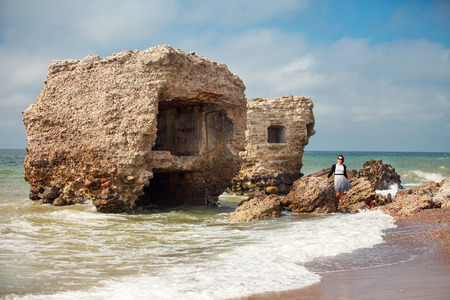 Stunning seascape with part of the old demolished forts in background in Liepaja, Latvia on the Baltic sea coast photo