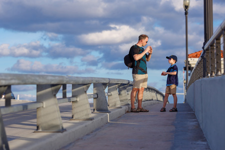 port everglades: Young father and son on Fort Lauderdale Bridge, Florida, USA