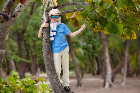 Cheerful little boy having relax outdoors during his summer vacation photo