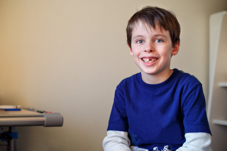 physiological: Portrait of cute little boy who lost his milk tooth