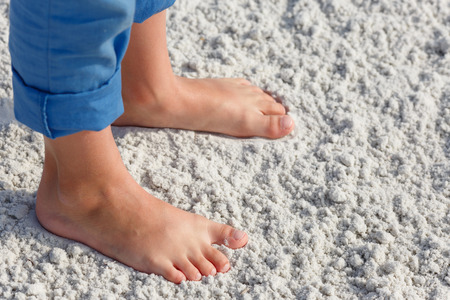 sandy feet: Close up of child feet on a tropical sandy beach, Florida, Siesta Key beach Stock Photo