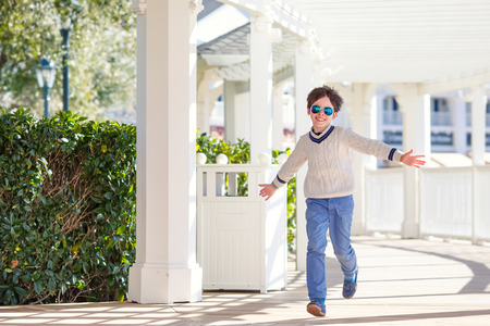 7 8 years: Cheerful little boy having fun outdoors during his summer vacation Stock Photo