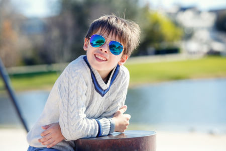 7 8 years: Cheerful little boy having relax outdoors during his summer vacation