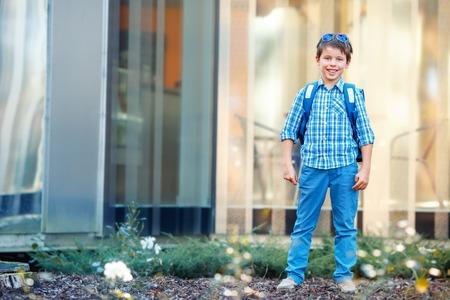 cute teen: Portrait of cute school boy with backpack outdoors