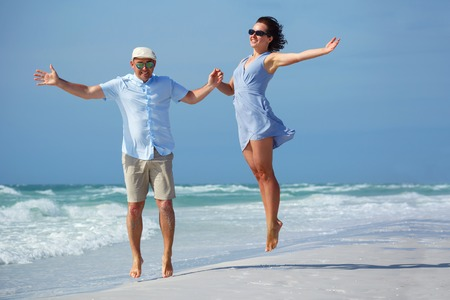 Young couple having fun at tropical beach during summer vacation, Siesta Key beach, Florida Stock Photo
