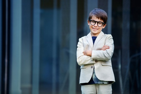 stylish man: Little boy in a nice suit and glasses. Back to school. Children portrait. Stylish kid in suit