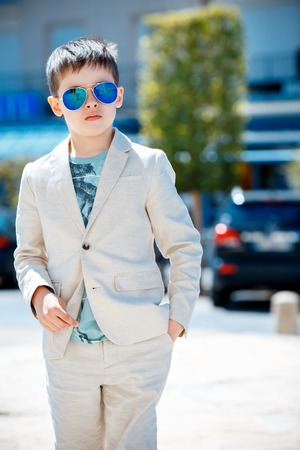 stylish men: Little boy in a nice suit and glasses. Back to school. Children portrait. Stylish kid in suit