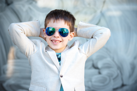 beautiful boy: Little boy in a nice suit and glasses. Back to school. Children portrait. Stylish kid in suit