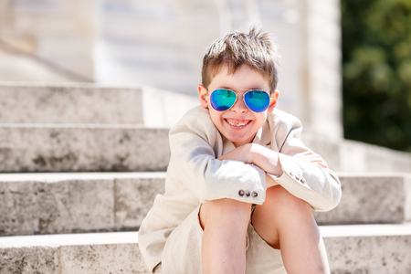 young boy smiling: Little boy in a nice suit and glasses.