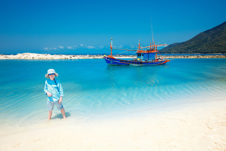 Cute little boy on Malibu beach at Koh Phangan Island, Thailand, Asia