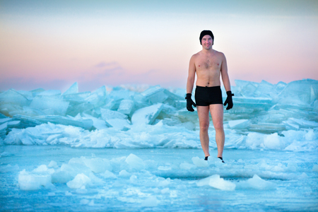 swimm: Man is going to swimm in an ice-hole, healthy lifestyle