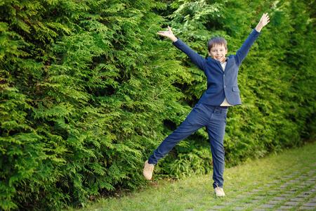 Cheerful little boy having fun outdoors Stock Photo