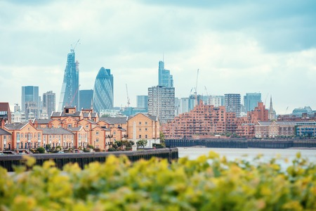 View of London Docklands with the Thames River, downtown, cucumber and city center Stock Photo