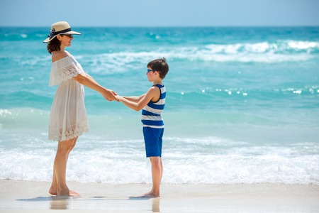 rin: Young mother and her son at Thai beach, Koh Phangan island, Thailand, Asia
