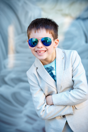 Little boy in a nice suit and glasses. Children portrait