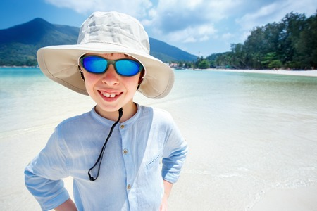 Cute little boy on Malibu beach at Koh Phangan Island, Thailand