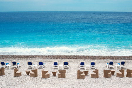 Chairs and tables on Nice beach along Promenade des Anglais