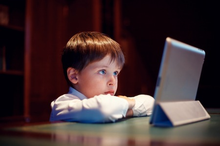 Cute little boy with a tablet pc Imagens - 71733174