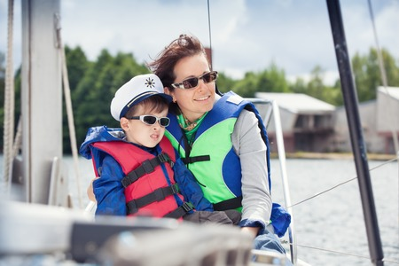 Family of two enjoying boat ride at lake