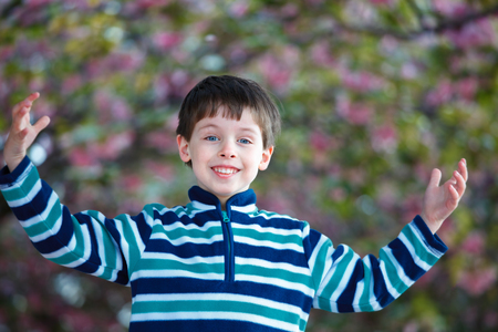 Cute little boy playing in spring garden Stock Photo