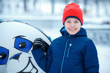 Cute little boy with snow tube playing outdoors