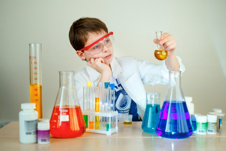 Cute boy is making science experiments in a laboratory Stock Photo