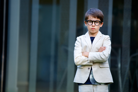Little boy in a nice suit and glasses. Back to school Stock Photo