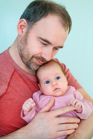 Cute newborn baby girl and her father Stock Photo