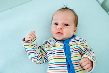 Cute two week old baby girl in cradle Stock Photo