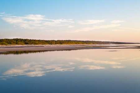 Baltic sea, perfect reflection, forest during sunset