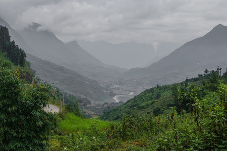 The picturesque valley in the cleft of the mountains photo