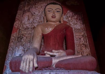 indo china: Buddha statue in the old temple. Bagan, Burma. Stock Photo