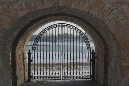 The iron gate in the Kremlin wall. Veliky Novgorod, Russia photo