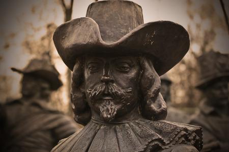 musketeer: A bronze sculpture of a man Stock Photo