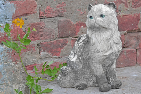 ladoga: Ceramic cat on the stairs Staraya Ladoga Holy Dormition nunnery Stock Photo