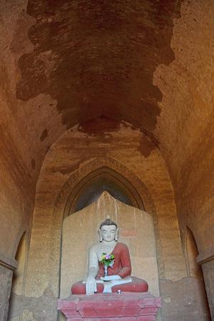 pacification: Buddha statue into the temple. Bagan, Myanmar (Burma) Editorial