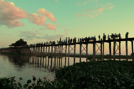 go for: The locals go for teak bridge U Bein at sunset. Mandalay Burma