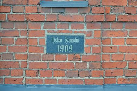 nameplate: Nameplate on the brick wall