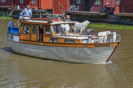 berth: Porvoo, Finland - July 25, 2015: Berth in the old town, boat with Labradors