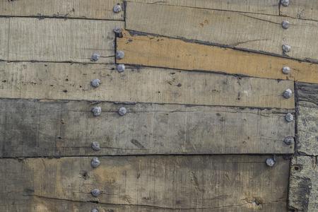 old metal: Old, vintage, wood with metal rivets. Background.