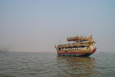 boatman: Boat near Holy Ghats of Varanasi