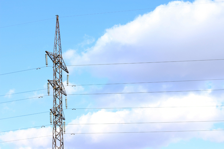 Power line against the blue sky with clouds power station wire communication