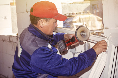 working installation plastic window working saw home construction repair Stock fotó - 122763389