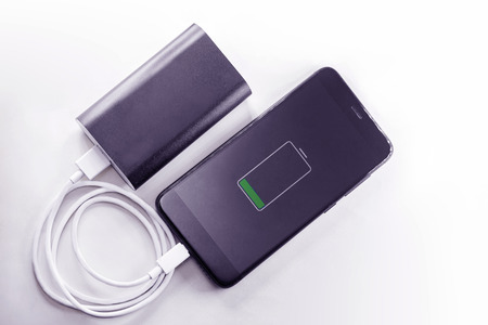 smartphone phone is charging from power bank portable mobile charging