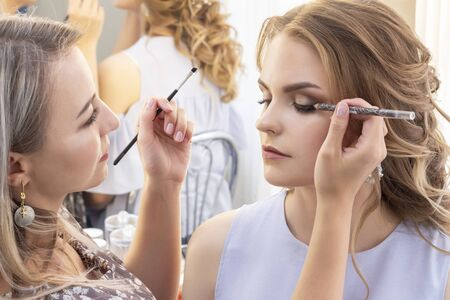 Makeup Artist Puts Make Up On Girl Model Wedding Makeup Evening